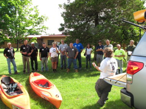 Carla Wagner of Wild Goose Chase instructs the class about use of kayaks. Photo by Stephen M. Vantassel.